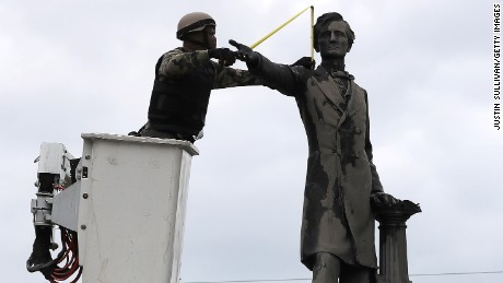 A statute of Confederate President Jefferson Davis came down in May in New Orleans.