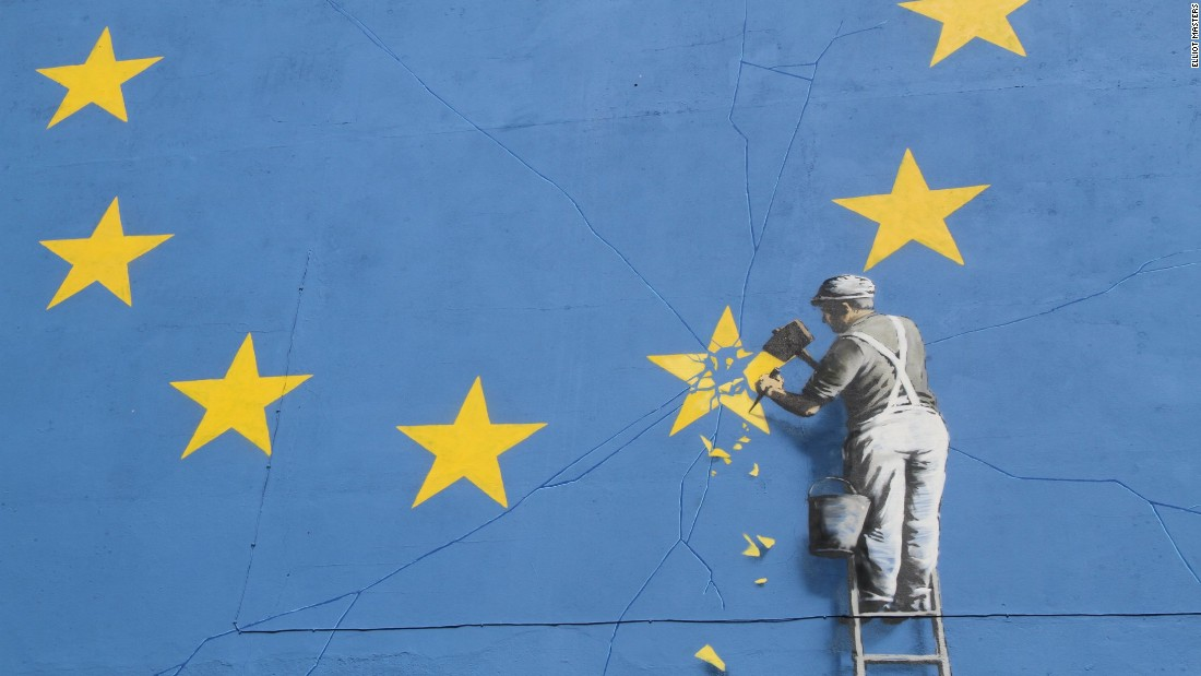 Elusive street artist Banksy has revealed a new mural. The large-scale painting depicts a worker chipping away at one of the twelve stars on the European Union flag.