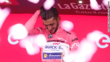 Colombia's Fernando Gaviria of team Quick-Step celebrates the pink jersey of the overall leader on the podium of the third stage of the 100th Giro d'Italia, Tour of Italy, cycling race from Tortoli to Cagliari on May 7, 2017 in Sardinia.  / AFP PHOTO / Luk BENIES        (Photo credit should read LUK BENIES/AFP/Getty Images)