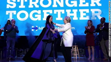 Democratic presidential nominee former Secretary of State Hillary Clinton (R) greets recording artist Katy Perry (L) during a get-out-the-vote concert at the Mann Center for the Performing Arts on November 5, 2016 in Philadelphia, Pennsylvania.