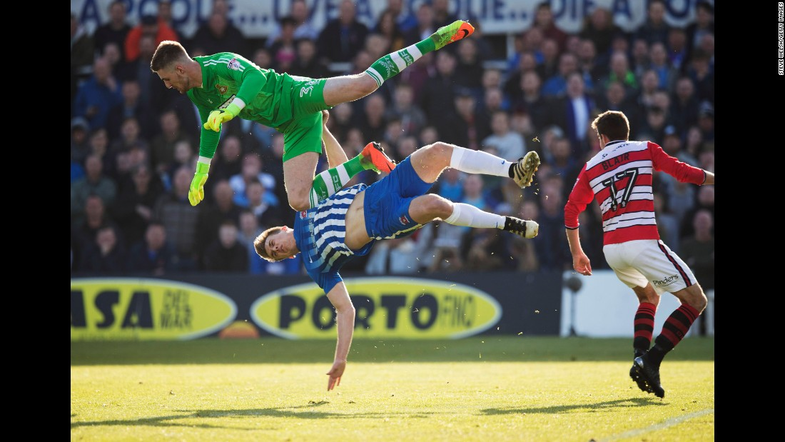 Ian Lawlor, a goalkeeper for Doncaster Rovers, collides with Hartlepool's Rhys Oates during a League Two match in Hartlepool, England, on Saturday, May 6.