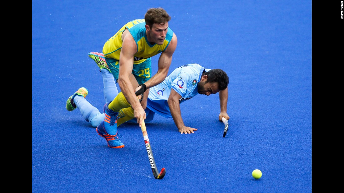 Australia's Trent Mitton gets past India's Affan Yousuf during a field hockey tournament in Ipoh, Malaysia, on Tuesday, May 2.