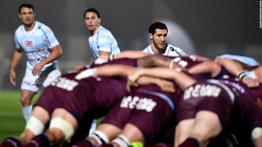 Rugby players from Racing 92 watch their teammates scrum with Bordeaux-Begles during a French league match in Colombes on Saturday, May 6.