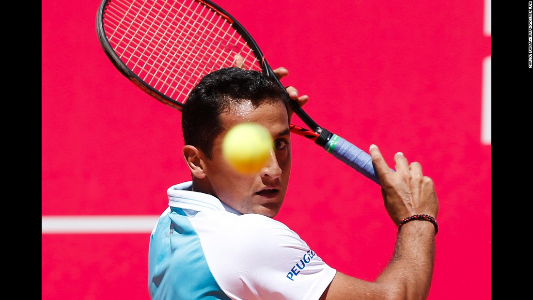 Nicolas Almagro prepares to hit a backhand during his first-round match at the Estoril Open in Portugal on Tuesday, May 2.