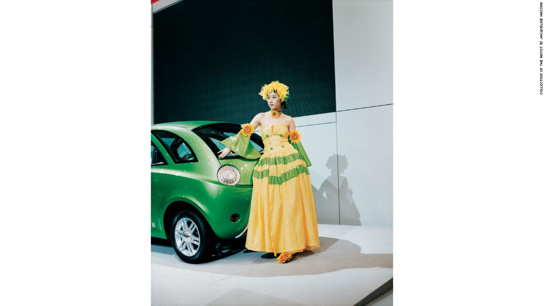 """The Dutch photographer <a href=""http://www.jacquelinehassink.com/jh/site/paragraph/item/22136"" target=""_blank"">Jacquline Hassink</a> spent five years photographing car shows in seven different cities across three continents in order to examine how major car brands ideal images of femininity to market their products and define their corporate identity."""