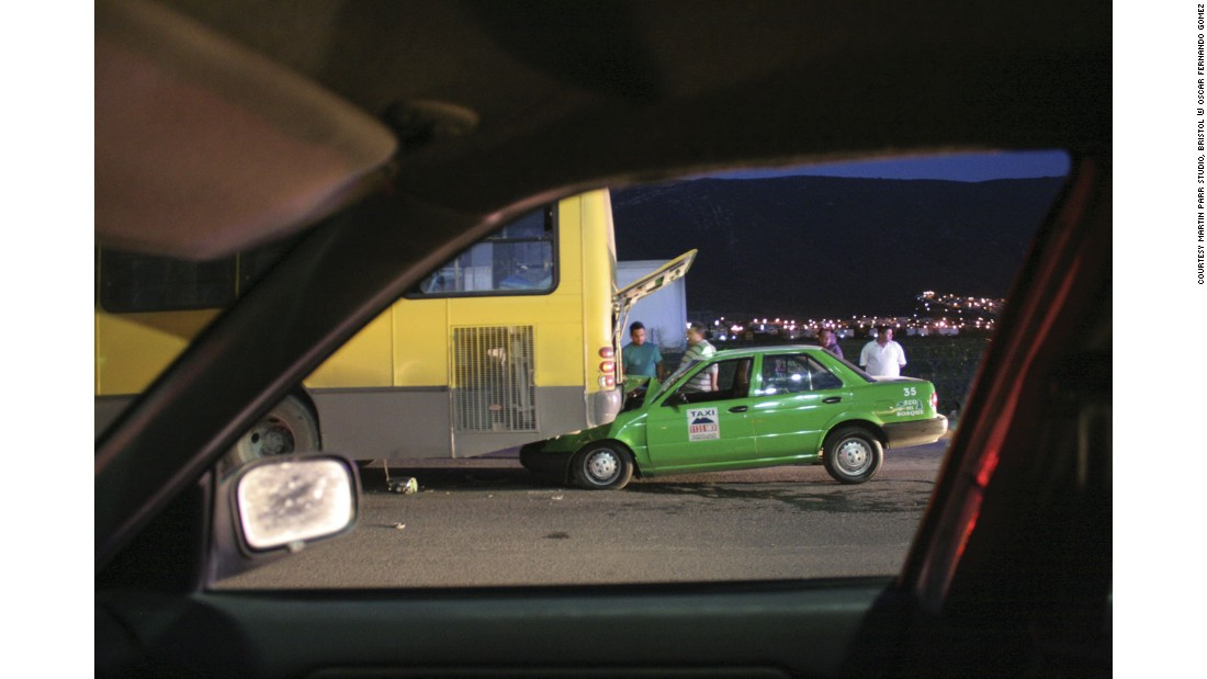 """It is interesting to see the many ways in which the car window is used as a compositional device in the works of the photographers presented in the exhibition. Gómez uses it systematically like a frame within a frame positioning the different scenes he observes from his car window centrally in the composition."""