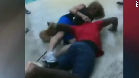The video shows a teenager and a woman falling in a pool area in  North Lauderdale, Florida.