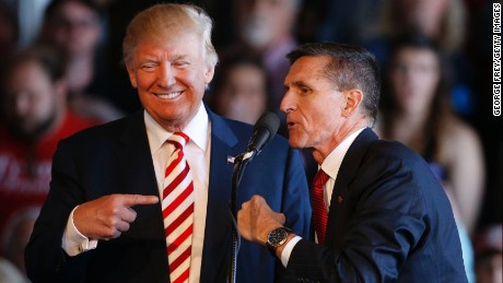 Republican presidential candidate Donald Trump jokes with retired Gen. Michael Flynn as they speak at a rally at Grand Junction Regional Airport on October 18, 2016 in Grand Junction Colorado.