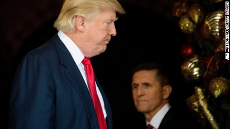US President-elect Donald Trump stands with Trump National Security Adviser Lt. General Michael Flynn at Mar-a-Lago in Palm Beach, Florida, where he is holding meetings on December 21, 2016.