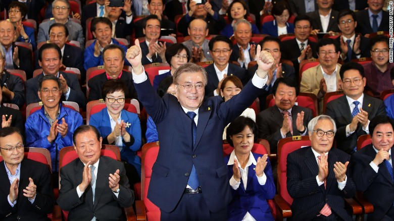 South Korean presidential candidate Moon Jae-in reacts Tuesday in Seoul after hearing exit poll results.