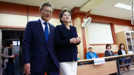 South Korean presidential candidate Moon Jae-in of the Democratic Party and his wife Kim Jung-suk arrive to cast their ballot for a presidential election at a junior high school in Seoul, South Korea, Tuesday, May 9, 2017. South Koreans voted Tuesday for a new president, with victory widely predicted for a liberal candidate who has pledged to improve ties with North Korea, re-examine a contentious U.S. missile defense shield and push sweeping economic changes. (Jeon Heon-kyun/Pool Photo via AP)