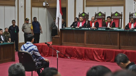 Ahok sits on the defendant's chair as he attends his sentencing hearing in Jakarta on May 9.