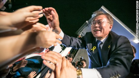 Mr. Moon Jae-in, the president-elect, greets supporters after his victory was confirmed on the presidential election on May 9, 2017 in Seoul, South Korea.