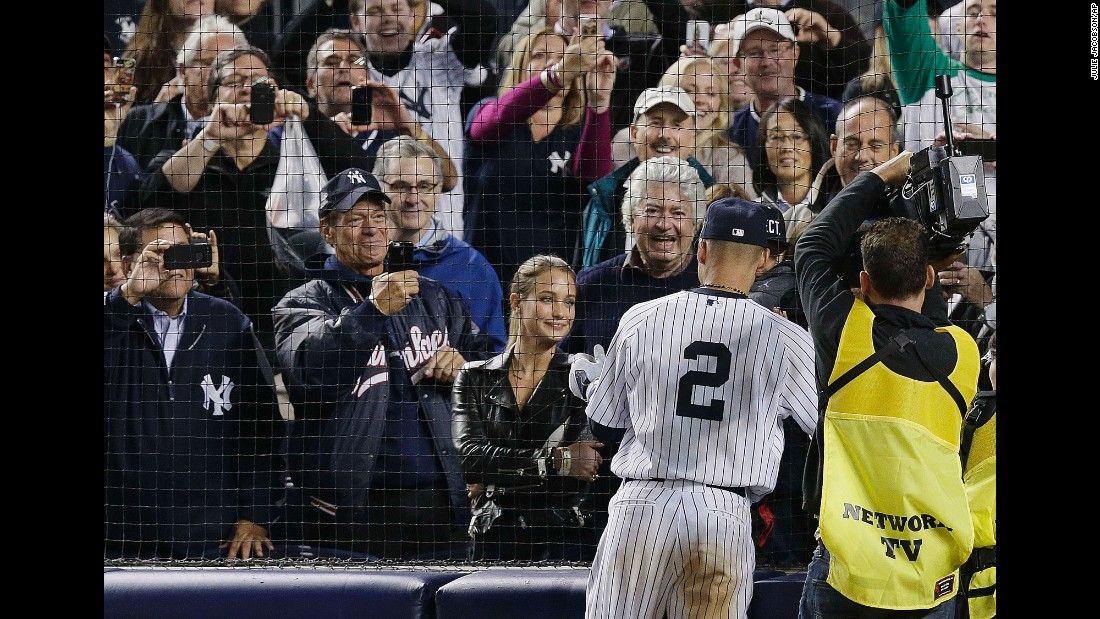 Jeter greets his girlfriend, model Hannah Davis, and some of his family members after playing his last home game. Jeter married Davis in 2016.