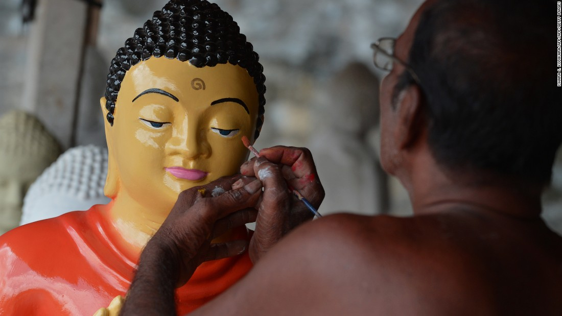 <strong>Dompe, Sri Lanka: </strong>A Sri Lankan artist works on Buddhist statues ahead of the Vesak Festival in Dompe, on the outskirts of Colombo, on May 7.