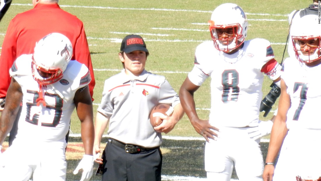 Ryan, here with 2016 Heisman winner Lamar Jackson, right, was able to enroll at the University of Louisville and became the football team's equipment manager.