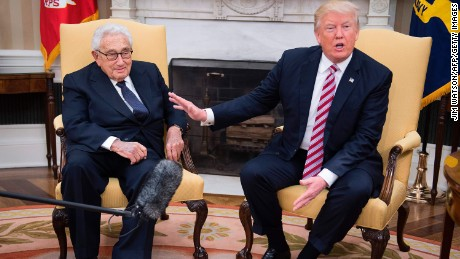 US President Donald Trump (R) speaks with former US Secretary of State Henry Kissinger during a meeting in the Oval Office of the White House in Washington, DC, May 10, 2017. / AFP PHOTO / JIM WATSON        (Photo credit should read JIM WATSON/AFP/Getty Images)