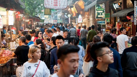 Tourist crowds pack the Muslim quarter in Xi'an, where mostly ethnic Hui Muslims run stores with traditional street food.