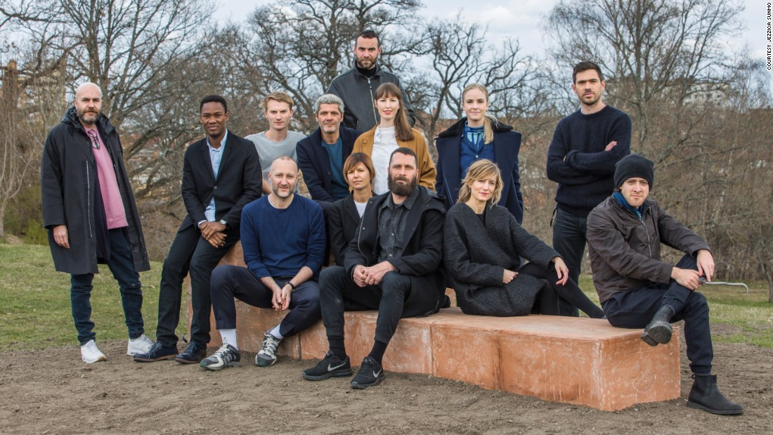 A group portrait of the architects and curators.