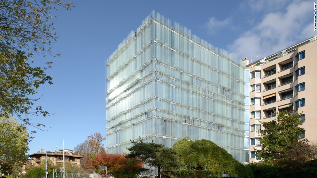 Laminated glass blades comprise the facade of the new headquarters of the Société Privée de Gérance (SPG) in Geneva. The reflections and transparencies of the building create a visual blurring effect.
