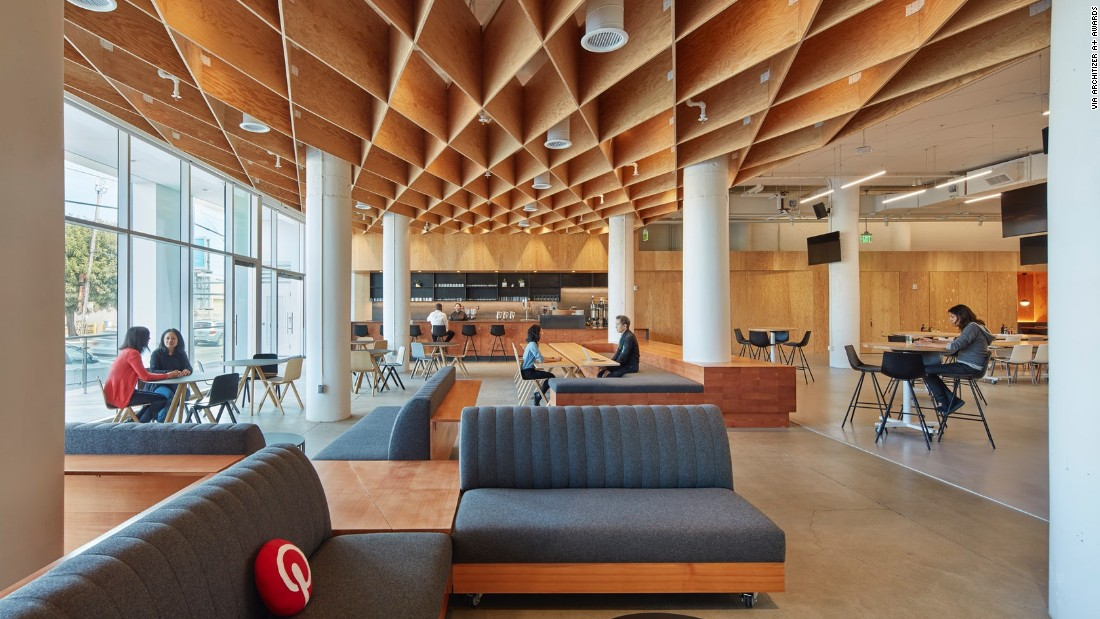The San Francisco design for Pinterest's new headquarters was formerly a John Deere factory. A diagrid waffle ceiling made from plywood acts as a canopy above spaces used for public events and programs.