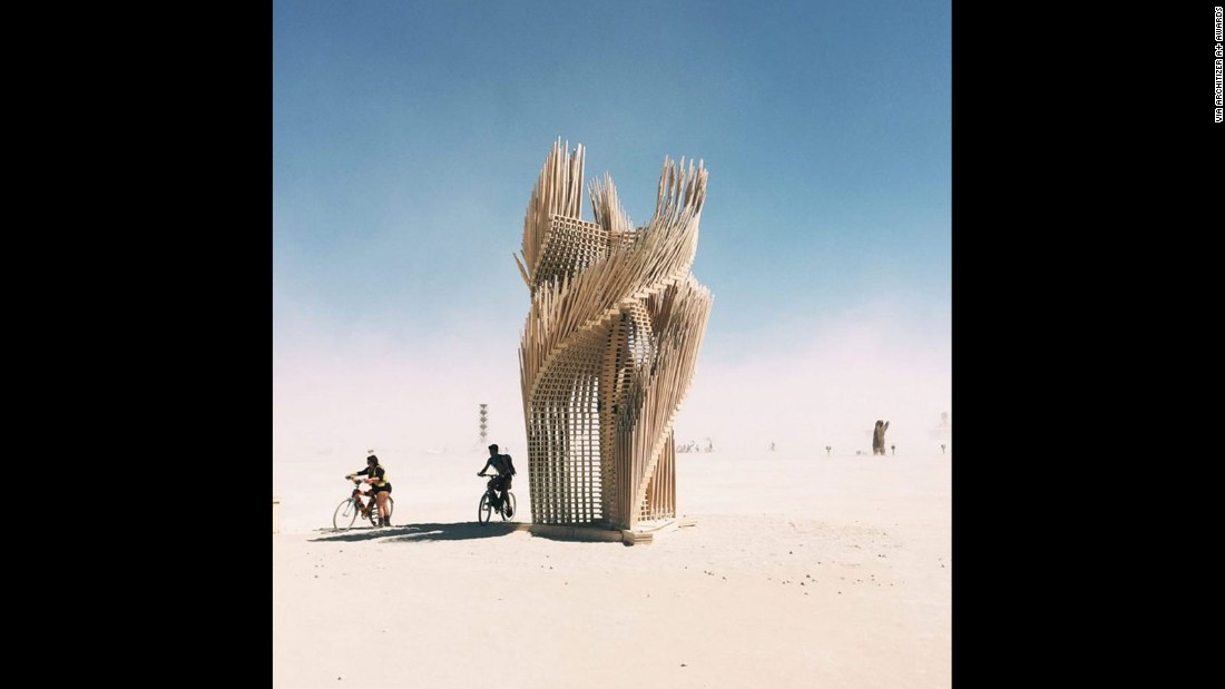 Tangential Dreams, a scalable tower built on site at Burning Man, is designed by London-based practice Mamou-Mani. It features one thousand light wooden pieces that weave into a helicoid structure.