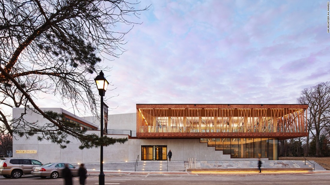 Built in 2016, Chicago-based Studio Gang Architects' design for the Writers Theatre in Glencoe, Illinois, uses timber trusses and a wooden lattice to support a second-floor gallery walk.