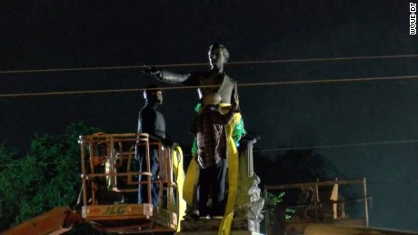 Workers prepare to remove the statue of Jefferson Davis.