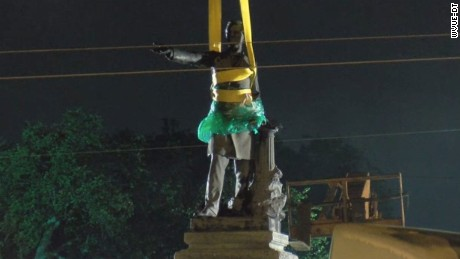 The Davis statue is wrapped in plastic and tied for removal.