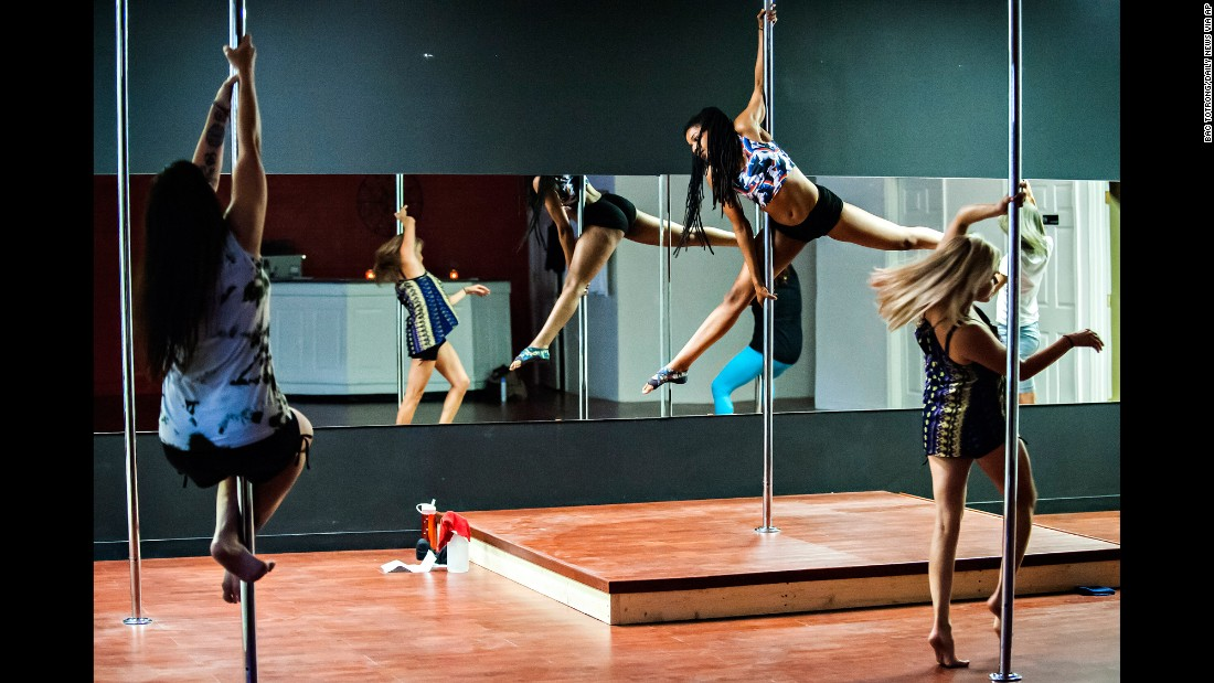 Atiya Hodges, center, teaches a pole dancing class at Taboo Dance & Fitness in Bowling Green, Kentucky. Experts say the class is a demanding one that requires skill and technique, which in turn uses energy.