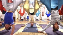 People enjoy aerial yoga using hammocks suspended from the ceiling in Tokyo. The trend is also called antigravity yoga.