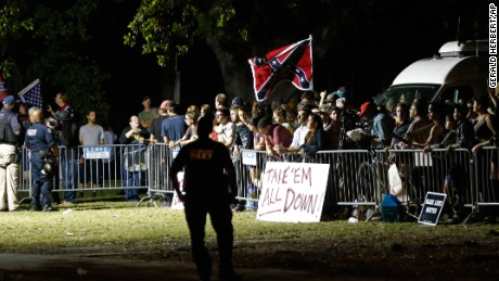 People in New Orleans demonstrate both for and against the removal of Confederate-era statues.