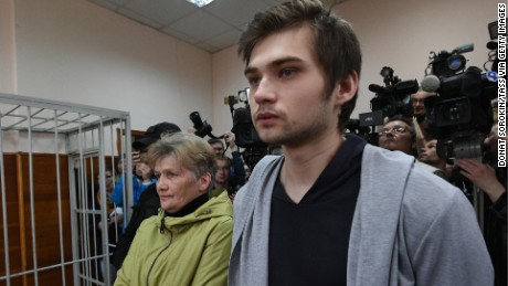 Russian blogger Ruslan Sokolovsky, right, attends a court hearing Thursday after he was charged for filming a Pokemon Go video in a church.