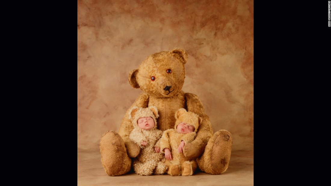 Newborn twins Jakob and Ezla cozy up to a teddy bear in 1998.