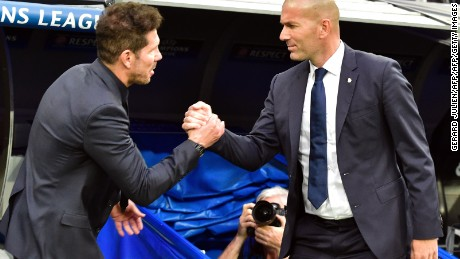 Atletico Madrid's Argentinian coach Diego Simeone (L) shakes hands with Real Madrid's French coach Zinedine Zidane beofre the UEFA Champions League semifinal first leg football match Real Madrid CF vs Club Atletico de Madrid at the Santiago Bernabeu stadium in Madrid, on May 2, 2017. / AFP PHOTO / GERARD JULIEN        (Photo credit should read GERARD JULIEN/AFP/Getty Images)