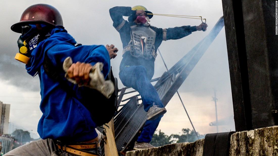 "Opposition activists clash with riot police in Caracas, Venezuela, during a protest against President Nicolas Maduro on Monday, May 8. Venezuela <a href=""http://www.cnn.com/2017/05/09/americas/venezuela-violin-protester/"" target=""_blank"">has been in a state of widespread unrest</a> since March 29, when the Venezuelan Supreme Court dissolved parliament and transferred all legislative powers to itself. Though the decision was reversed three days later, <a href=""http://www.cnn.com/2017/04/12/world/gallery/venezuela-protests/index.html"" target=""_blank"">protests continued across the country,</a> which is in the grip of severe food shortages and an economic crisis."