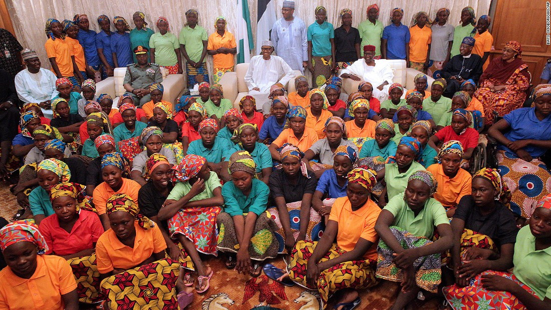 "In this photo released by the Nigeria State House on Sunday, May 7, Nigerian President Muhammadu Buhari -- at center, in the glasses -- meets with the 82 Chibok schoolgirls who were recently released by the terrorist group Boko Haram. The Nigerian government freed five Boko Haram commanders in what was <a href=""http://www.cnn.com/2017/05/07/africa/chibok-girls-released/index.html"" target=""_blank"">a swap deal,</a> said Sen. Shehu Sani, who was part of the negotiating effort. More than 100 girls remain in Boko Haram custody."