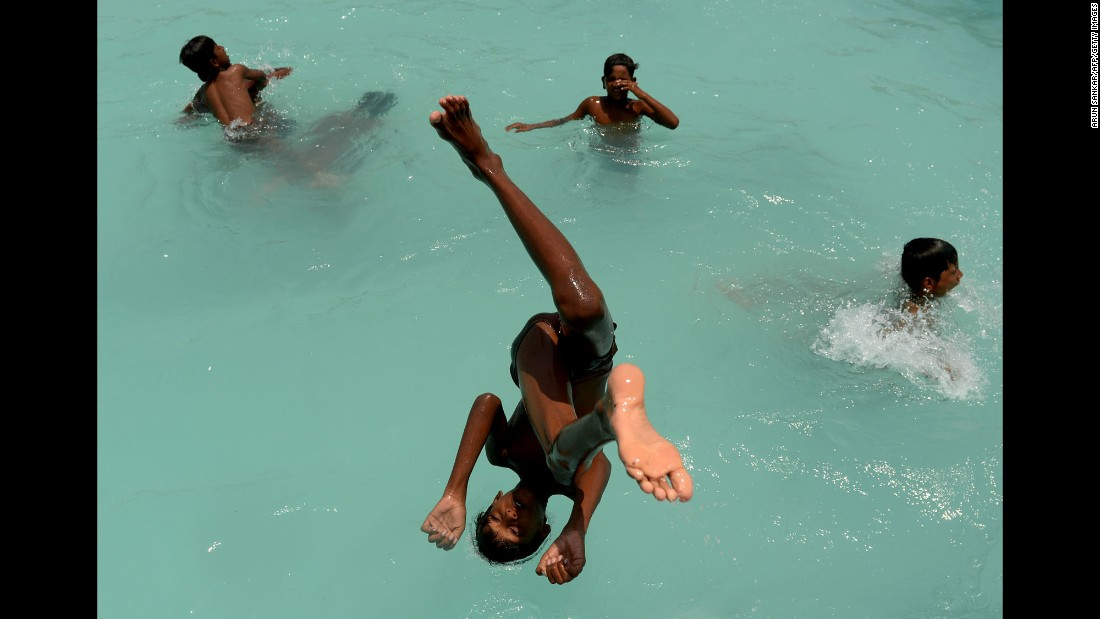 A boy dives into a swimming pool in Chennai, India, on Wednesday, May 10.