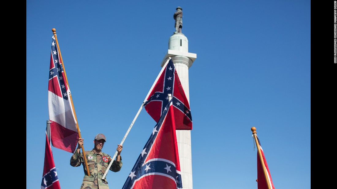 "A man holds Confederate flags in New Orleans on Sunday, May 7, as he protests <a href=""http://www.cnn.com/2017/05/11/us/new-orleans-confederate-monument-removal/"" target=""_blank"">the city's removal of Confederate monuments.</a> Mayor Mitch Landrieu's office said the statues will go to storage while the city looks for a suitable venue to display them."