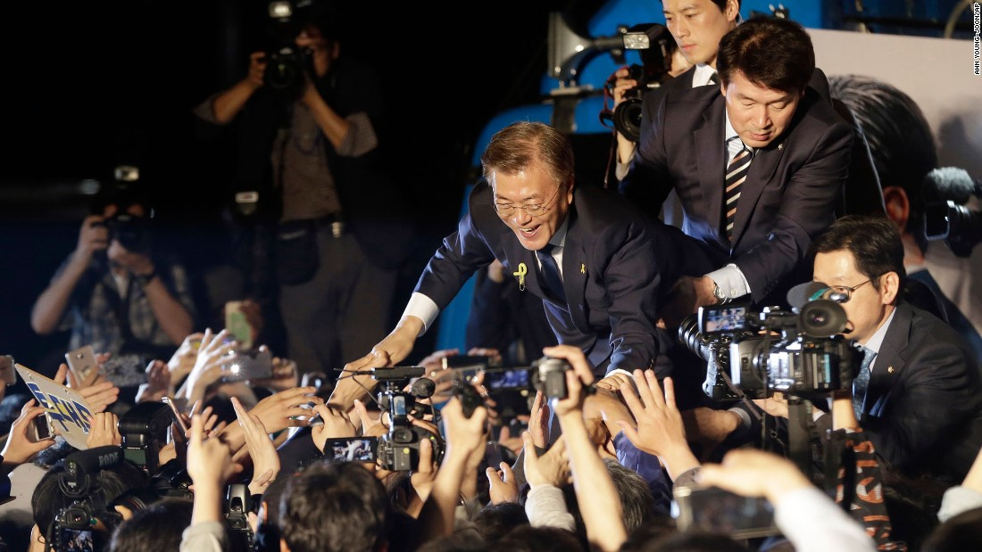 "South Korean President-elect Moon Jae-in is greeted by supporters in Seoul on Wednesday, May 10. Moon, a liberal who favors a more open policy toward North Korea, <a href=""http://www.cnn.com/2017/05/09/asia/south-korea-election/"" target=""_blank"">was declared the winner</a> Wednesday by the country's National Election Commission."