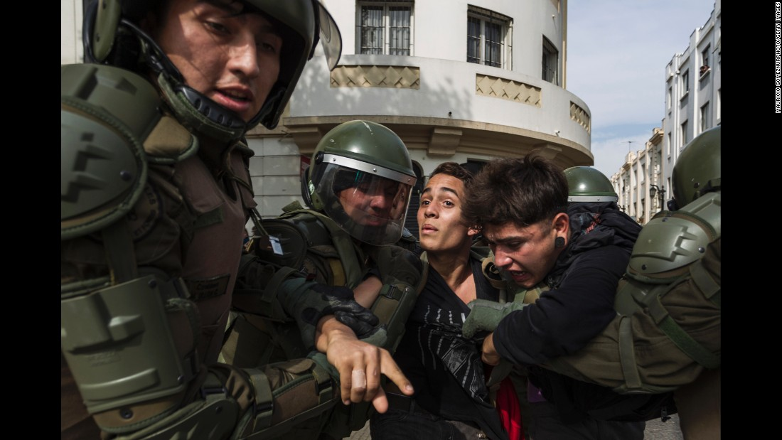 A demonstrator is detained in Santiago, Chile, on Tuesday, May 9. People marched in cities across Chile to call for free higher education and an end to student debt.