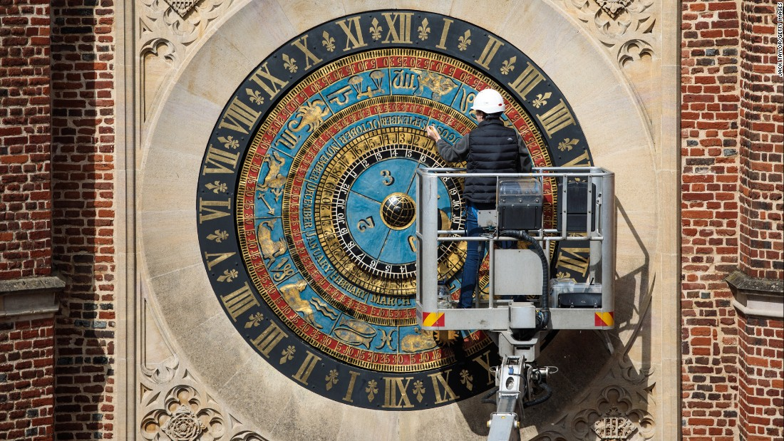 A conservator touches up the paintwork on an astronomical clock in London on Friday, May 5. The still-functioning clock was built in the year 1540.