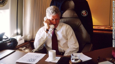 President Clinton, on Air Force One in 1997, with the crossword