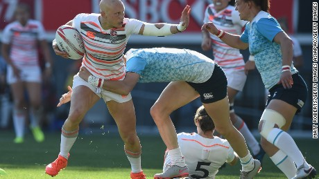 Fisher tries to hand off a Russian tackler in the last round of the HSBC Women's Sevens World Series