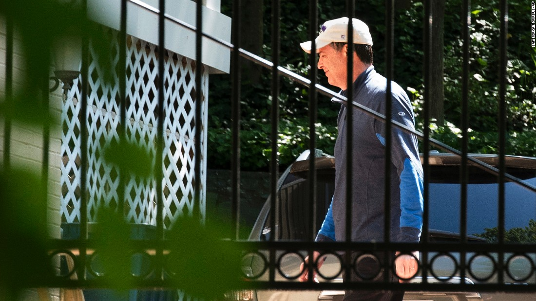 "Former FBI Director James Comey walks at his home in McLean, Virginia, on Wednesday, May 10. Comey was dismissed from his post, the White House said, on the recommendation of Attorney General Jeff Sessions and Deputy Attorney General Rod Rosenstein. They cited Comey's handling of the probe into Hillary Clinton's use of a private email server, a controversy that many believe helped Trump defeat Clinton in the 2016 election. <a href=""http://www.cnn.com/2016/07/07/politics/who-is-james-comey-fbi-director-things-to-know/index.html"" target=""_blank"">7 things to know about James Comey</a>"