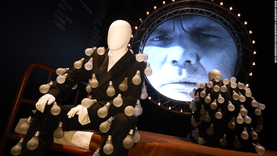 "A display showing the mannequins dressed in a ""lightbulb suits"" on display in the exhibition from the ""Delicate Sound of Thunder"" album."