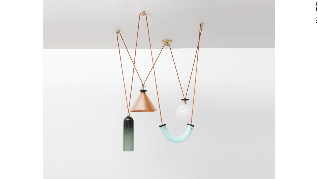 """We've been writing about or exhibiting <a href=""http://www.ladiesandgentlemenstudio.com/"" target=""_blank"">Ladies & Gentlemen</a>'s work since their debut in 2012 -- a collection of chairs and lights in leather, copper, and brass whose aesthetic was a harbinger of the warm minimalism we've been seeing over the past few years. All of their work stems from an exploration of basic shapes and elemental materials, as well as a fascination with balance, and each outing is more sophisticated than the last. They've recently been dipping a toe into the idea of bringing their aesthetic to a whole interiors experience, and we hope there's more of that to come."""