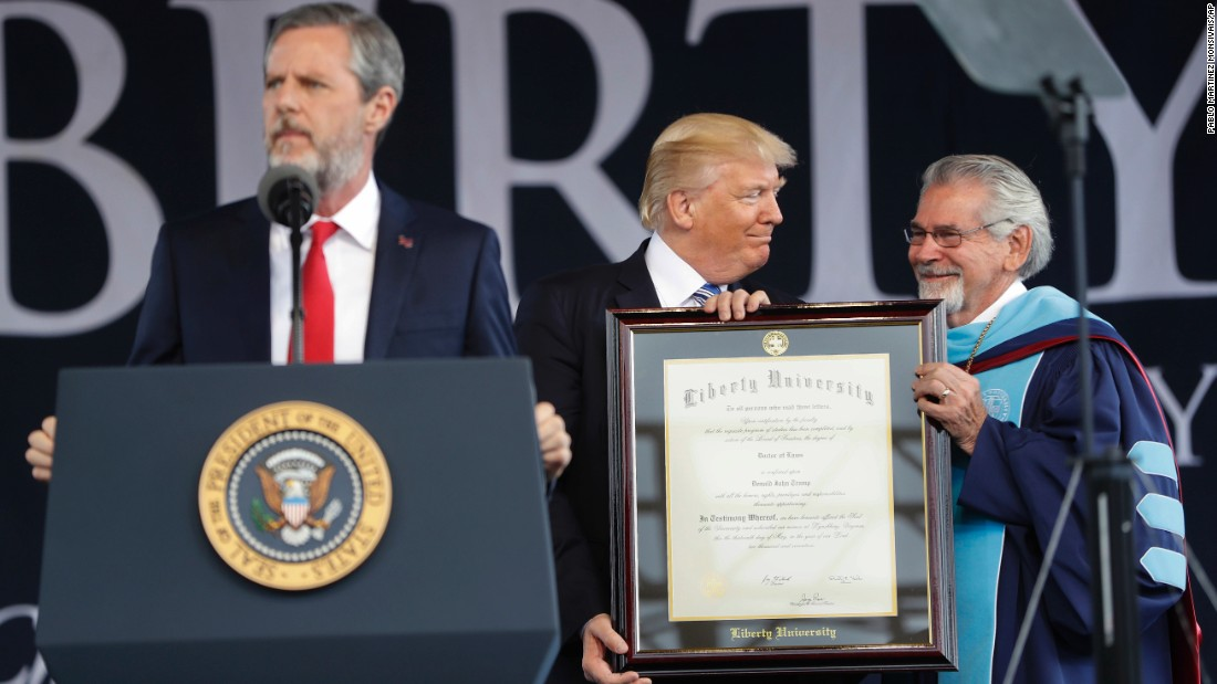 "President Trump is presented with an honorary degree by Liberty University provost Ronald E. Hawkins, right, before <a href=""http://www.cnn.com/2017/05/13/politics/trump-liberty-commencement-speech/"" target=""_blank"">giving a commencement speech</a> in Lynchburg, Virginia, on Saturday, May 13. Speaking at the podium is Liberty University President Jerry Falwell."