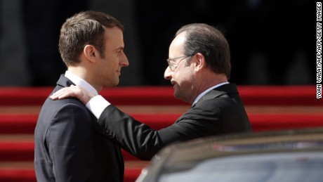 Emmanuel Macron shows his predessor, Francois Hollande, to his car at the Elysee Palace on Sunday.