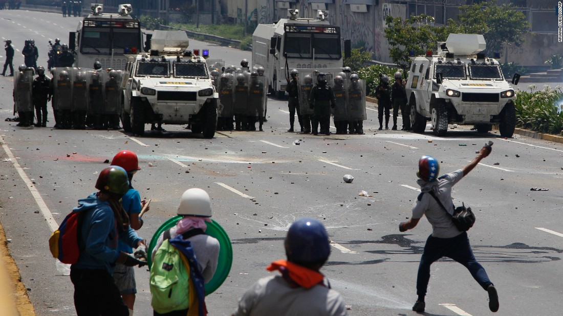 Anti-government protesters face off against military forces during an opposition march in Caracas on Wednesday, May 10.